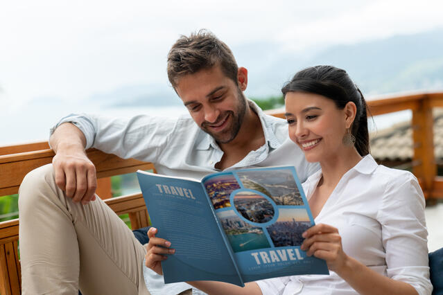 Happy couple reading helpful Trading Places timeshare exchange directory